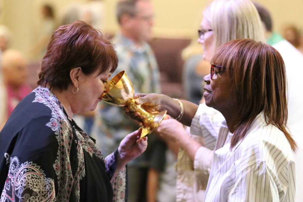 Woman Drinking Sacramental Wine During Communion