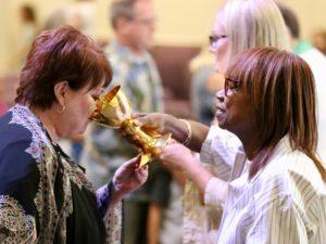Woman Drinking Sacramental Wine During Communion