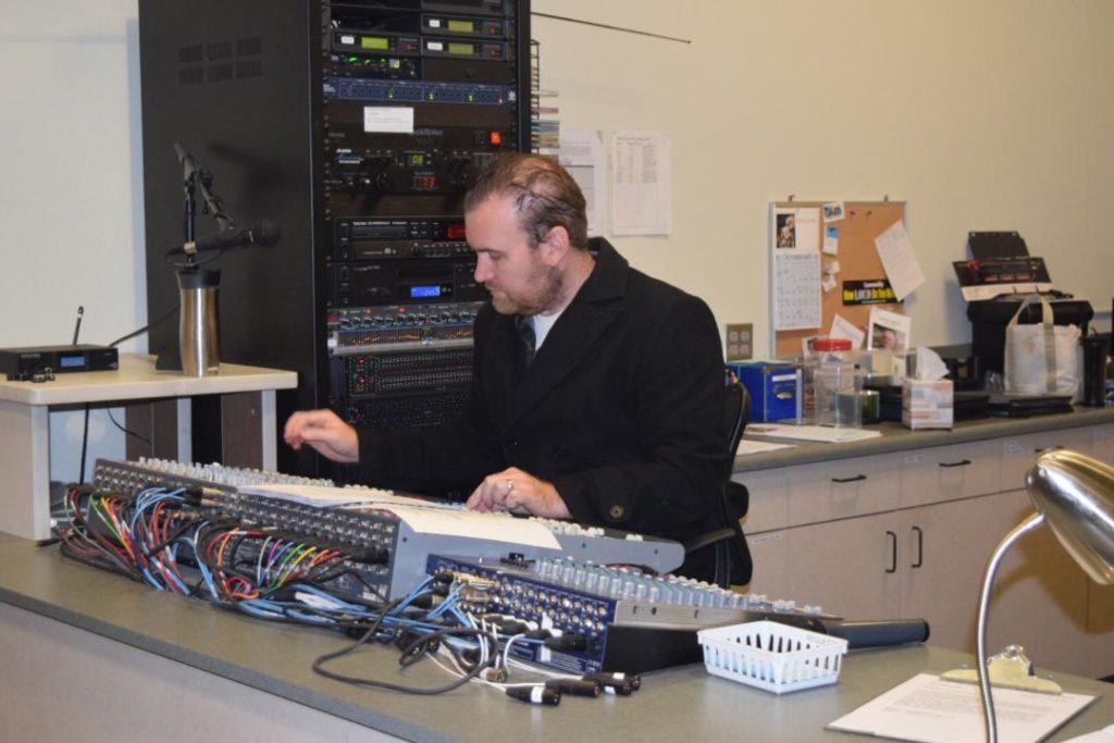 Man Using Sound Board